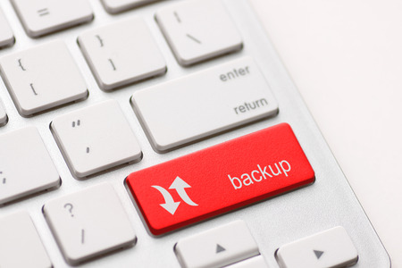 backing up: Backup Computer Key In red For Archiving And Storage
