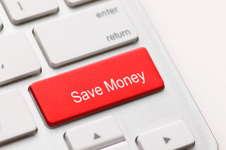 save money for investment concept with a red button on computer keyboard photo