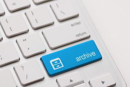 archive enter button key on white background photo