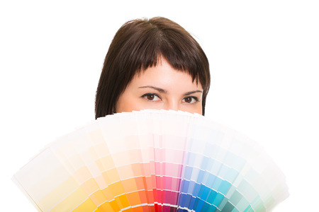Young woman holding a color palette  Isolated white background  photo