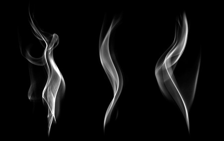 Abstract white smoke swirls on black background  Imagens