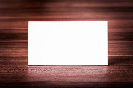 Blank corporate identity business card on wood  photo