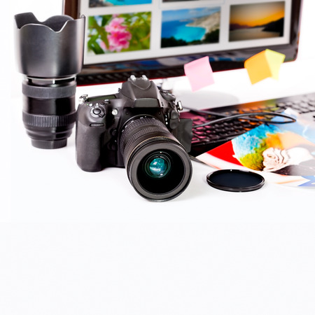 Photography concept  Digital camera, monitor and photos on white background