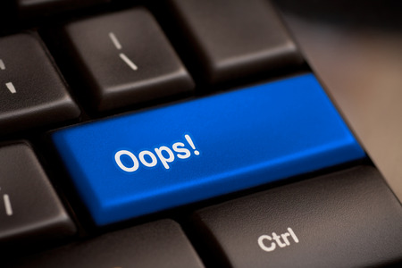oops: oops word on key showing fail failure mistake or sorry concept Stock Photo