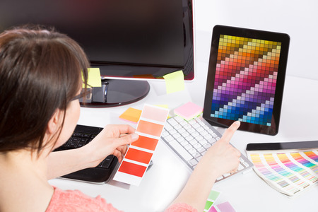 Graphic designer at work  Color swatch samples  photo