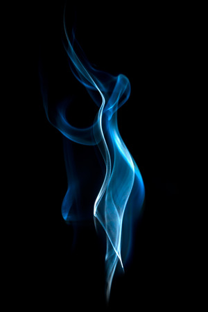 Abstract blue smoke swirls on black background