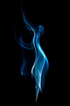 cigar smoke: Abstract blue smoke swirls on black background