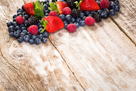 Fruit on wooden background  Summer or spring organic fruits over wood  photo