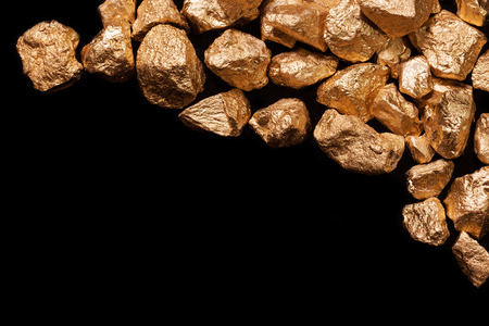 precious metal: Gold nuggets isolated on black background