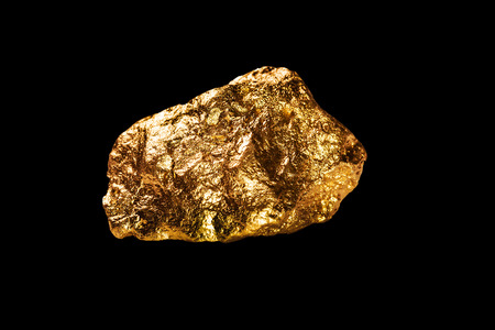 Gold nugget isolated on black background