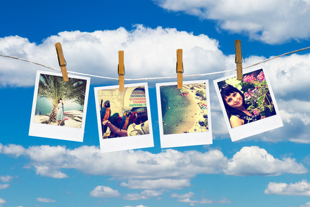 polaroid frame: Photos of holiday hanging on clothesline by clothespins  Sky and cloud on background