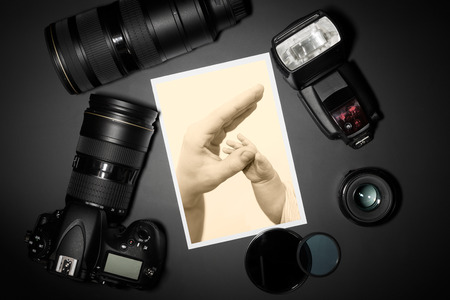 photographing: camera and lense on black showing photographer still life