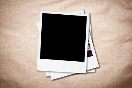 instant: Blank instant photo frames on old paper background  Stock Photo
