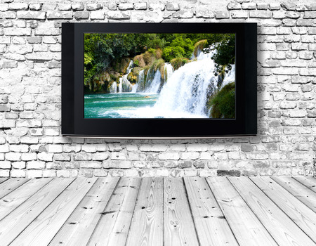 flat display panel: interior with a television set on an old wall Stock Photo