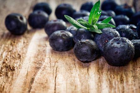 blueberry jam: Blueberries on wooden background