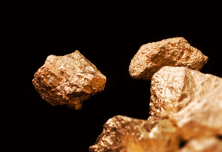 tough luck: Gold nuggets isolated on black background