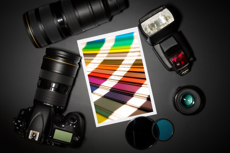 stock photograph: camera and lense on black showing photographer still life