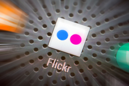 flickr: BELCHATOW, POLAND - APRIL 10, 2014: Closeup photo of Flickr icon on mobile phone screen. Popular social network.