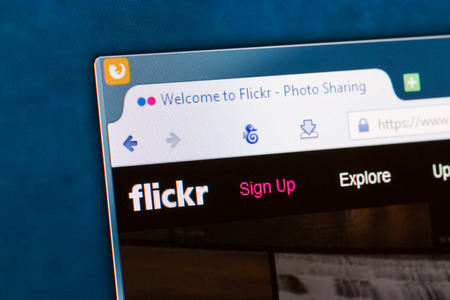 flickr: BELCHATOW, POLAND - APRIL 11, 2014: Photo of Flickr social network homepage on a monitor screen. Editorial