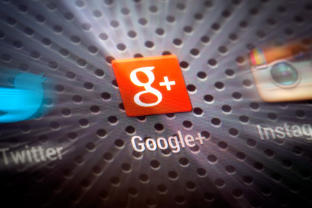 google: BELCHATOW, POLAND - APRIL 10, 2014: Closeup photo of Google Plus icon on mobile phone screen. Popular social network.