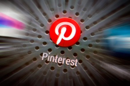 BELCHATOW, POLAND - APRIL 10, 2014: Closeup photo of Pinterest icon on mobile phone screen. Popular social network.