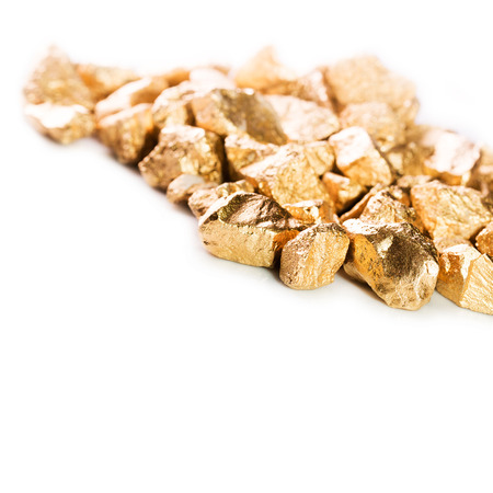 Gold nuggets isolated on white background. Stock Photo