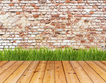brick background: Old wall and green grass on wood floor background. High resolution. Stock Photo