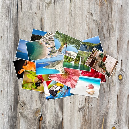 Old paper and photos. Objects over wooden planks. photo