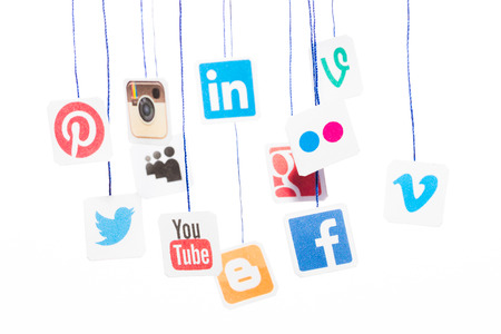 BELCHATOW, POLAND - AUGUST 31, 2014: Popular social media website logos printed on paper and hanging on strings. 에디토리얼