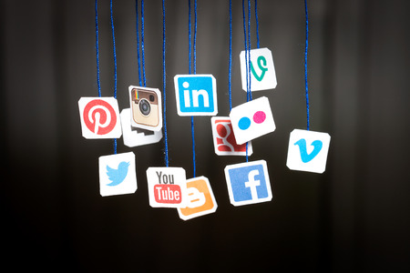 BELCHATOW, POLAND - AUGUST 31, 2014: Popular social media website logos printed on paper and hanging on strings.