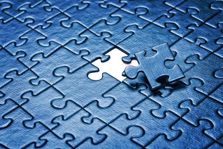 puzzle business: Last piece of jigsaw puzzle. Stock Photo