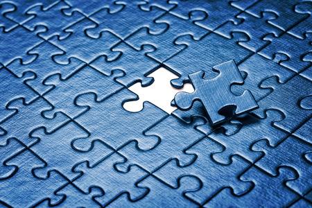 Last piece of jigsaw puzzle. Standard-Bild