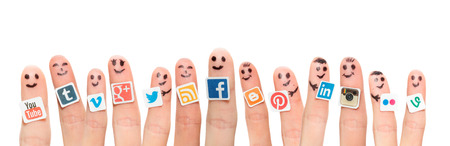 BELCHATOW, POLAND - AUGUST 31, 2014: Happy group of finger smileys with popular social media logos printed on paper and stuck to the fingers.
