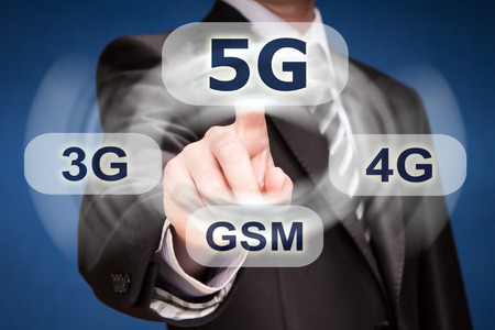 lte: businessman is pushing his finger on 5g button Stock Photo