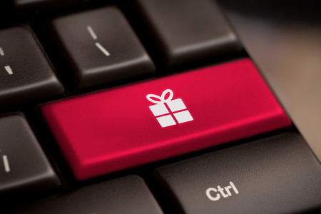 Christmas key with gift box icon on laptop keyboard photo