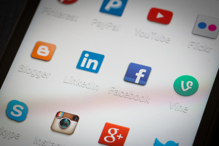 BELCHATOW, POLAND - APRIL 06, 2014: Social media icons on smart phone screen Editorial