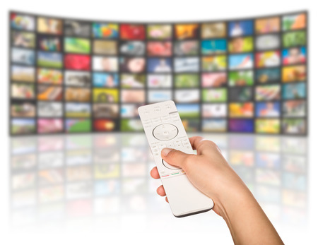 LCD TV panels. Television production technology concept. Remote control. Stock Photo