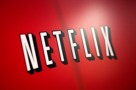 vod: BELCHATOW, POLAND - January 06, 2015: Photo of the Netflix logo on a monitor screen.