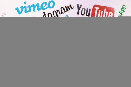 vimeo: BELCHATOW, POLAND - DECEMBER 28, 2014: Popular social media website logos on computer screen