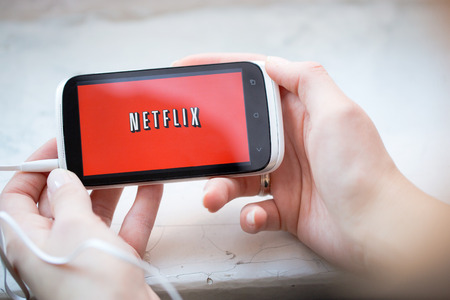 vod: BELCHATOW, POLAND - January 06, 2015: Netflix service logo on phone.