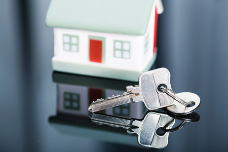 annuities: Keys with house on background.
