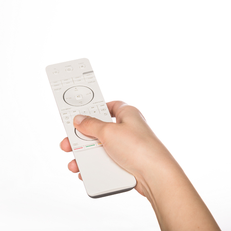 bluray: Hand with remote control. Isolated on white background. Stock Photo