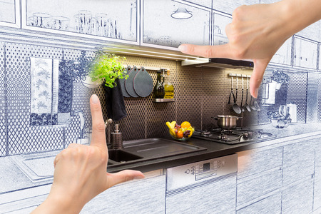 사용자 정의 부엌 디자인을 프레임 여성의 손. 조합 도면 및 사진.
