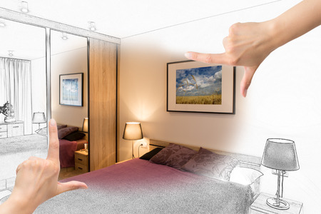 design drawing: Female hands framing custom bedroom design. Combination drawing and photo.