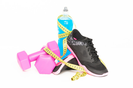 sports clothing: Pair of sport shoes and fitness accessories. White background.