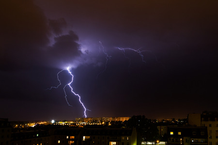 lightnings: Clouds and thunder lightnings and storm over city. Stock Photo