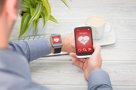gadget: Businessman uses smart watch and phone. Smartwatch concept.