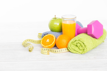 body toning: Fitness concept with dumbbells and healthy food.