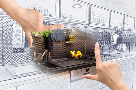 design drawing: Female hands framing custom kitchen design. Combination drawing and photo. Stock Photo