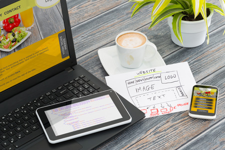website layout: Designers desk with responsive web design concept.